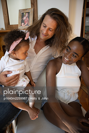 Multi ethnic family with toddler girl - p1640m2259987 by Holly & John