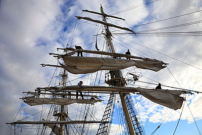 Sailors are working in the rigging of a brig, loosening the sails. - p1072m1022103 by KuS