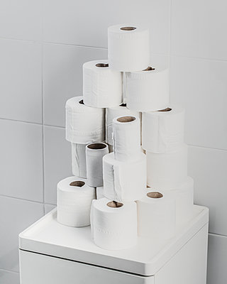 Piled toilet rolls - p1130m1119531 by Jonathan Kitchen