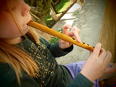 Girl playing the recorder - p132m900672 by Peer Hanslik