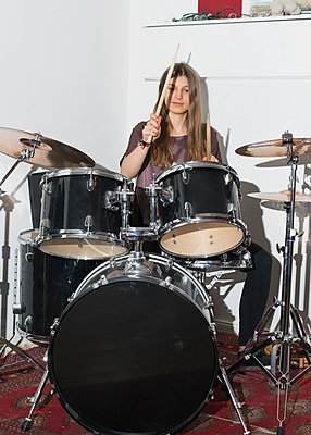 Young woman playing drums - p301m1130797f by Halfdark