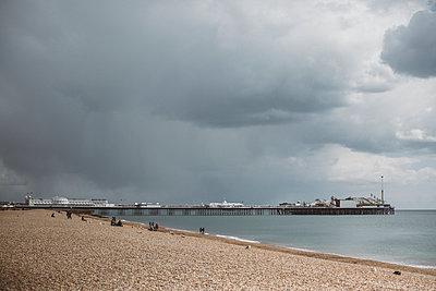 Storm clouds above beach - p312m2079505 by Amanda Falkman