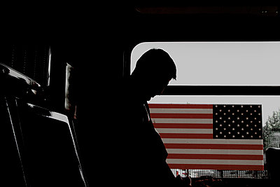 American society. Man in a bus, Brooklyn, New York City - p1028m2204193 by Jean Marmeisse