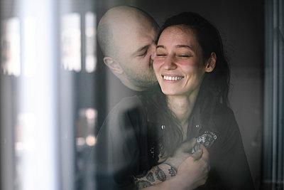 Couple in love behind windowpane - p300m2114110 by Ekaterina Yakunina