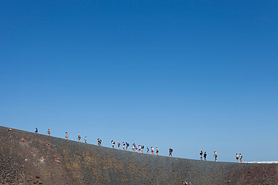 Hiking the Nea Kameni volcano in Santorin island, Greece - p590m1486917 by Philippe Dureuil