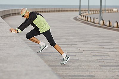 Fit Senior Man Working Out At Seafront - p1166m2147049 by Cavan Images