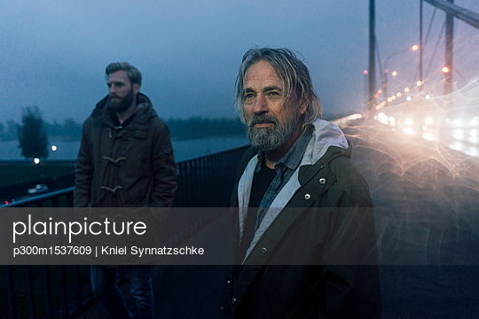 Father and son meeting on bridge, discussing business - p300m1537609 by Kniel Synnatzschke