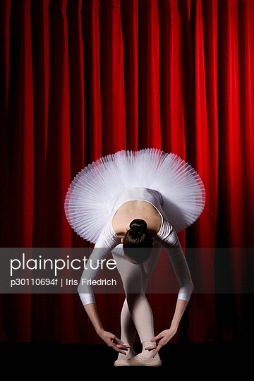 A ballet dancer posing on stage
