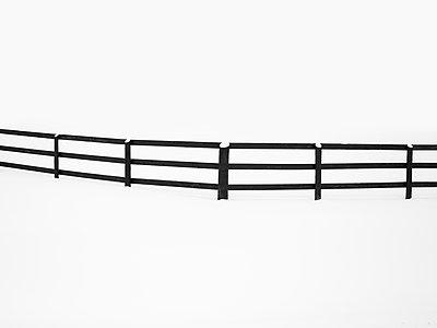 Wooden fence across field of snow - p1335m1586387 by Daniel Cullen