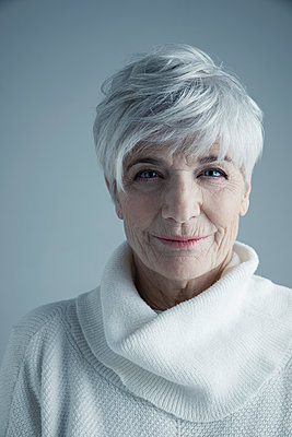 Portrait confident Caucasian senior woman with short white hair wearing white sweater - p1192m1213196 by Hero Images