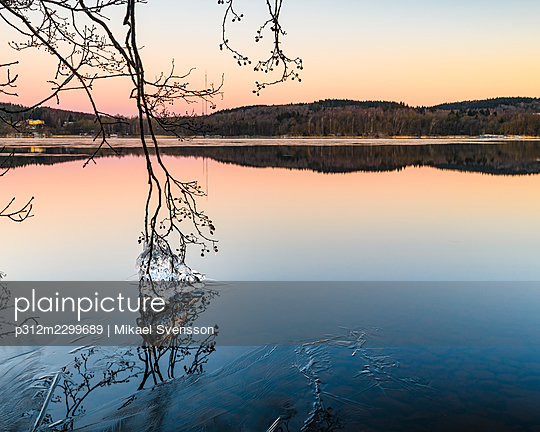 View of lake at sunset - p312m2299689 by Mikael Svensson