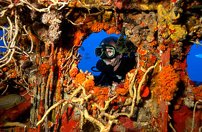 Looking through porthole. - p9243597f by Image Source
