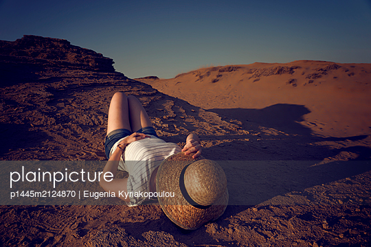 Woman with straw hat - p1445m2124870 by Eugenia Kyriakopoulou