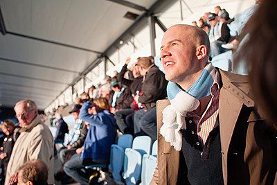 Mid adult man watching soccer game - p1185m1078011f by Adam Haglund