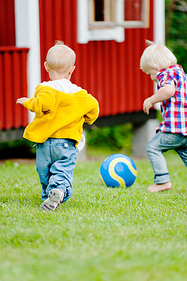 Boys playing football - p312m1229100 by Rebecca Wallin
