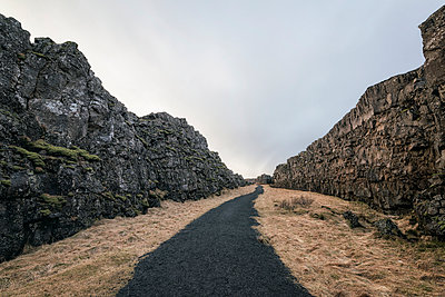 Dirt path between rock formations - p555m1491159 by Patrick Lienin