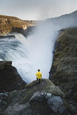 Hiker by Gullfoss waterfall in Iceland - p1427m2077613 by Oleksii Karamanov