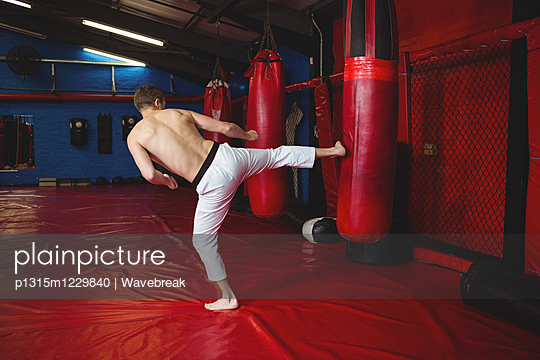Karate player practicing kickboxing