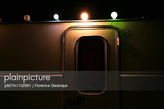 Fairy lights on a caravan - p927m1132561 by Florence Delahaye