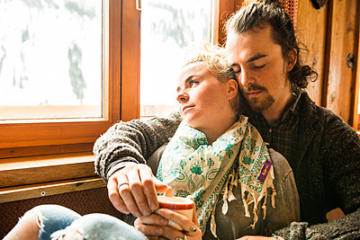 Couple in a mountain cabin - p1142m1035029 by Runar Lind