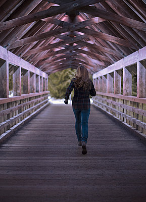 Woman Running Away on a Covered Bridge - p1617m2192188 by Barb McKinney