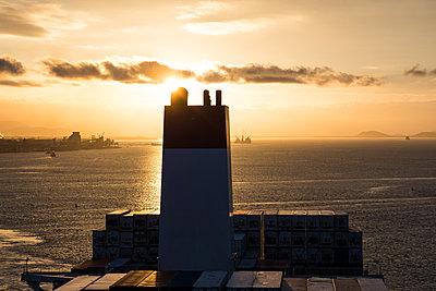 Ship funnel on container ship - p930m2148410 by Ignatio Bravo