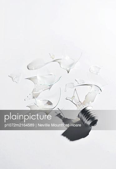 Smashed Lightbulb - p1072m2164589 by Neville Mountford-Hoare