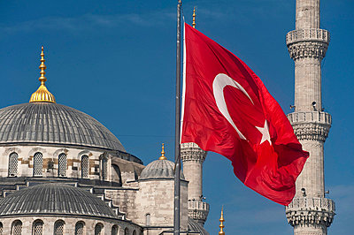 Turkish flag in front of the Sultanahmet or Blue Mosque - p6441447 by Ian Cumming