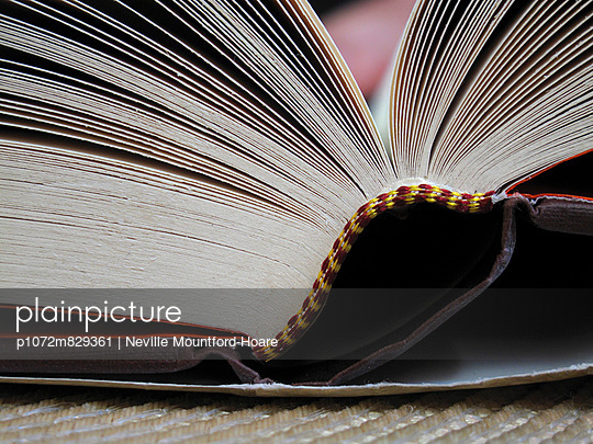 Edge of a hardback book - p1072m829361 by Neville Mountford-Hoare
