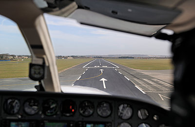 Airplane landing pilots view - p1048m1123530 by Mark Wagner