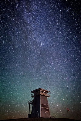 Tower against star field at night - p1166m1174099 by Cavan Images