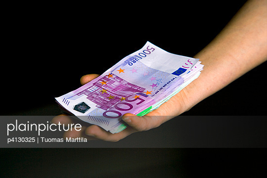 Womans holding pile of euro notes - p4130325 by Tuomas Marttila