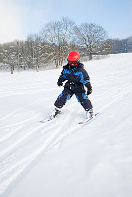 Boy skiing - p42911237f by Stefanie Grewel