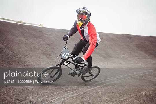 Cyclist riding BMX bike