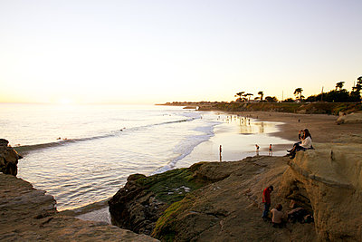 Beach life at sunset - p1106m1589467 by Angela DeCenzo