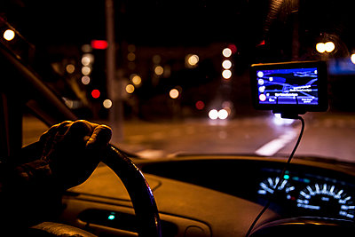 Cropped image of man driving car at night - p426m858189f by Katja Kircher