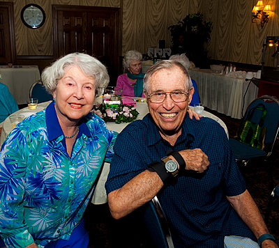 Older Caucasian couple smiling at party in retirement home - p555m1408812 by Shestock