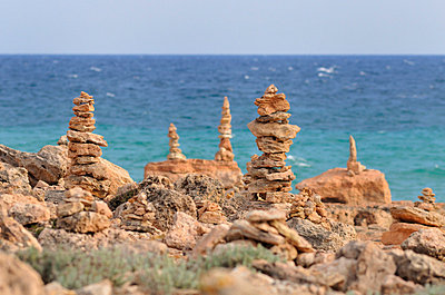 Hundreds of stone cairns - p8850149 by Oliver Brenneisen
