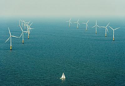Sailing boat sails close to Amalia windfarm, IJmuiden, Noord-Holland, Netherlands - p429m2004579 by Mischa Keijser