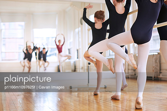 Little ballet dancers (6-7, 8-9) practicing with teacher