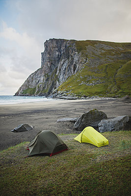 Tents on Kvalvika beach in Lofoten Islands, Norway - p1427m2186492 by Oleksii Karamanov