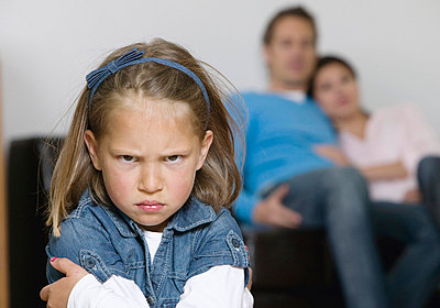 Angry girl, parents in the background - p4737768f by STOCK4B-RF