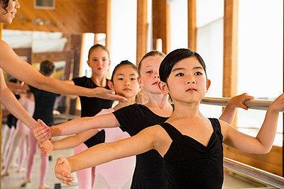 Ballerinas practising at the barre in ballet school - p924m825937f by Florin Prunoiu