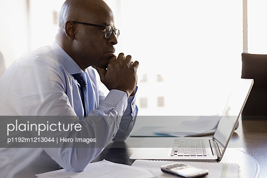 Focused lawyer working at laptop