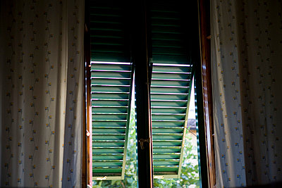 Afternoon light through wooden shutters - p3882892 by mary gaudin