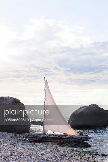 Raft on beach - p956m892319 by Anna Quinn