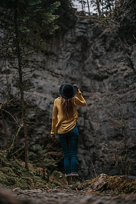 Woman is walking through the Rakov Skocjan cave system in Slovenia - p1455m2081791 by Ingmar Wein