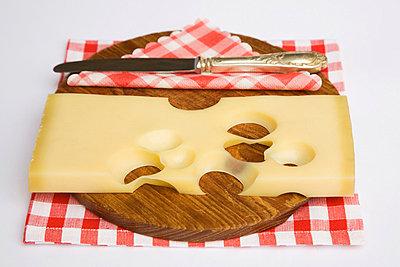 Cheese on chopping board - p3007020f by Gaby Wojciech