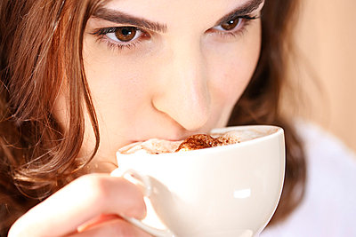 Woman drinking coffee - p6790096 by Jessica Alice Hath