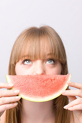 Young woman with water melon - p6691167 by Julian Winslow
